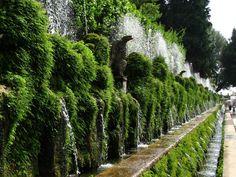 Wander through the lush gardens of the Villa d'Este in Tivoli, Italy