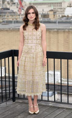 Keira Knightley gave Carrie Bradshaw a run for her money in gold Mary Janes that complemented her metallic Simone Rocha number at the London Begin Again photocall.