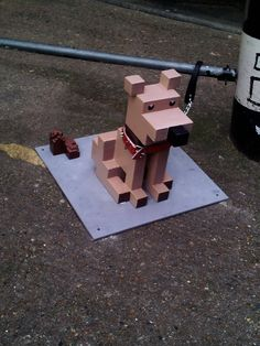 Disney created an 8-bit lane street art exhibit to push their film, Wreck-It Ralph ( in UK theaters February 8). The scene was built on Brick Lane in the old Truman's Brewery in London. The sculptures were created by Aden Hynes and his team at Sculpture Studios.