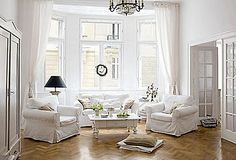 i purchased four white slipcovered chairs like these for the conversation area on first floor