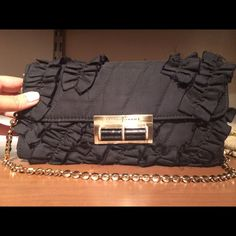 Ivanka Trump black ruffle and gold chain clutch Elegant and classy. Ivanka trump black ruffle clutch. Gold chain strap. Worn twice great condition! Too cute to just sit on my shelf! Ivanka Trump Bags Clutches & Wristlets