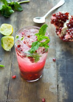Pomegranate Mojito Cocktail - refreshing, with healthy antioxidants this would make a great holiday drink. Healthy, sweet, simple, NYE. #pomegranate #mojito #recipe $mint #line #NYE