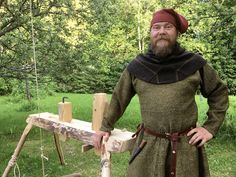 14th century carpenter and his pole lathe. Handmade tunic and striped hood.