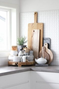 wood cutting boards, marble containers as kitchen decorations