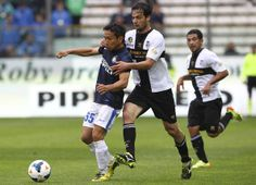 Yuto Nagatomo of FC Internazionale Milano competes for the ball with Marco Parolo of Parma FC during the Serie A match between Parma FC and ...