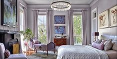 In the master bedroom, the coverlet and curtains are of Dedar fabrics, the Magni chair is in a Pierre Frey fabric, and the French chaise and Italian dresser are antiques. The chandelier is by Coup Studio, and the walls are in Sherwin-Williams's Unique Gray. #masterbedroom #savannahdesign #inspiringrooms
