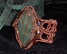 Modified Celtic Bracelet Cuff by Millie Fee, a jasper cabochon wrapped with copper wire.