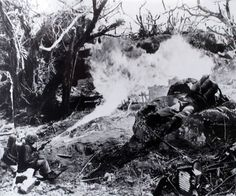 Flamethrower of US 2nd Marine Division clearing a path through jungle growth Tarawa Gilbert Islands November 1943.