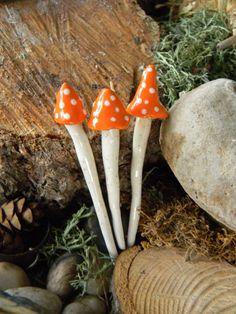 3 ceramic mushroom miniatures 3 Orange Poison.. ..  terrarium or miniature container fairy gardens. $10.50, via Etsy.