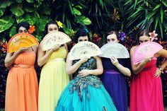 Bridesmaids - think one navy blue, one forest green, one rich bright purple. Love the hair flowers too.