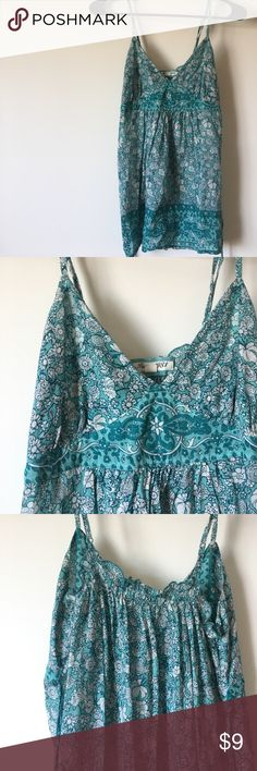 Floral patterned top! This top was my favorite top! It's time to let it go. It's been stitched a little on one strap but it's still in really good condition. Size small and fits really well. It allows you to tie around so it fits snugly to your body! Forever 21 Tops Tank Tops