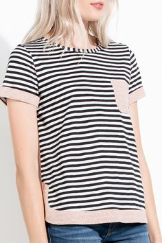 This classic black and white striped top is updated with a rounded hem and print contrast detail great dressed up or down for spring and summer!