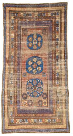 A Khotan carpet, East Turkestan | lot | Sotheby's