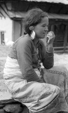 Nepal | Woman wearing a large ear ornament.  Those, Ramechhap district. 1957 | Ethnic group; Tamang, Rai, Sunuwar | ©SOAS, Nicholas Haimendorf