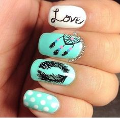 Mint, white and black decorated nails.