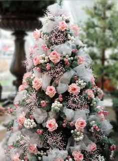 small pink rosebuds and babys breath can decorate any miniature tree