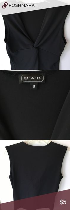 BAD sleeveless top BAD black plunging v neck top. Great to wear alone or layer. Nylon and Lycra mix BAD Tops Blouses