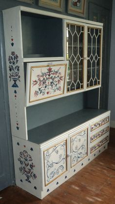 Scandinavian folk art bespoke wall unit, drink's display cabinet, drawers, cupboard hand painted inside and out.