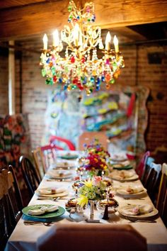 Gorgeous Tablescape for a boho chic wedding. That chandelier is tadah for!