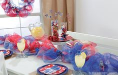 We loved the idea of a bunch-and-twist garland draped down the center of a table. The volume adds instant fireworks— without any fuss. Perfect for Memorial Day or 4th of July parties!