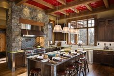 love the rock enclosed oven and range and wood beam ceiling. My wife would prefer white cabinetry to go with the rest and maybe some beadboard for a back splash instead of hideous subway tile.