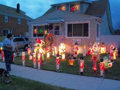 """Christmas light display -- """"This year we put more stuff and lights for our son Chad who is coming home from the Army for the holidays."""" City: Saint Clair Shores 