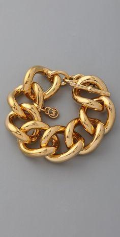 Gold michael kors bracelet.