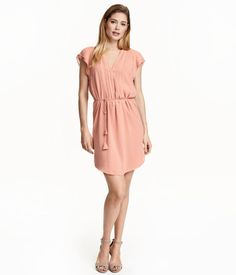 Knee-length dress in airy, woven fabric with butterfly sleeves. Concealed buttons at front, tie at waist, and gently rounded hem. Lined.