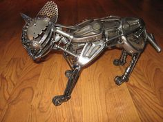 Cat, made from golf clubs and other scrap metal. AlkolaiArts on Facebook