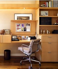 The desktops open and close with spring-loaded levers on both sides; the lid raises to reveal a corkboard on the underside. The drawers hold files and also conceal the printer.