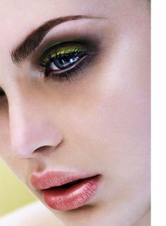 Smokey eye with a bright green liner on top lid. Beautiful.