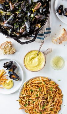 Moules frites, the Belgian dish of mussels and fries and a year-round favorite. There are many recipes, with beer, wine, and liquor sauces, but this mixture of garlic aioli, shallots, fennel, and crushed red pepper (or piment d'esplette) is nothing short of moules gold.