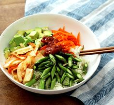 Raw vegan summer bibimbap loaded with fresh asparagus, carrots, avocado, and kimchi. So delicious and full of flavor. You'll definitely make this again!