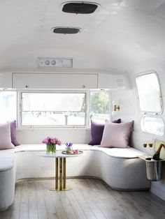 great floors and love the light interior of this remodeled Journelle Airstream | Rue