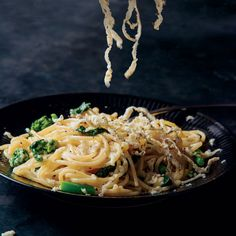 Spaghetti with Cacio e Pepe Butter | The gloriously simple, beloved cacio e pepe just got even simpler and faster in this Spaghetti with Cacio e Pepe Butter. Get the recipe at Food & Wine.