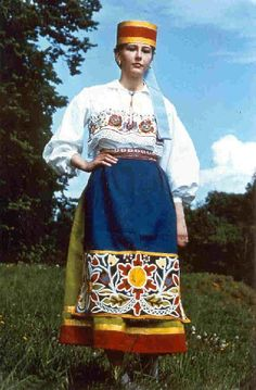 Europe | Portrait of a woman wearing traditional clothes, Estonia