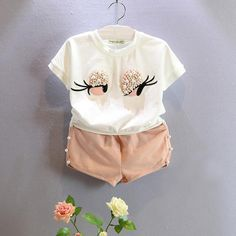 - Lovely long eyelashes toddler Girl tops + pants - Model Number: BTZ167 - Collar: O-Neck - Closure Type: Pullover - Sleeve Length(cm): Short - Material: Lycra,Cotton - Fit: Fits true to size, take your normal size - Gender: Girls - Pattern Type: Cartoon - Sleeve Style: Regular - Outerwear Type: Coat - Style: Novelty