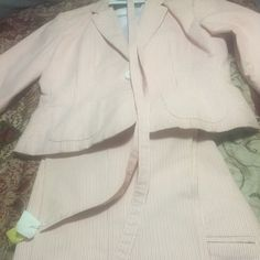 2 piece Capri set. 2 piece Capri pander with jacket/pants. The jacket is fully lined. The set is in excellent condition. It comes with a belt. The color is a pink/white stripe. Other