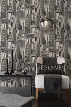 Genuine Flock Wallpaper Skyline Flock  - Black/Silver - 99270 Skyline flock is an exciting and eye catching dramatic paste the wall design. Printed with genuine flock, this contemporary flock follows the trend for cityscapes. and has metallic accents £74.99 per roll