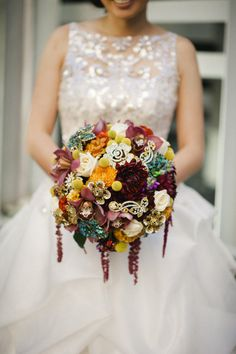 Ever think of adding floral brooches to your bridal bouquet?  This stunning floral bouquet is accented with floral brooches. The best of both beautiful worlds! Photography by sarahmaren.com