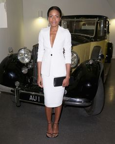 Naomie Harris in Burberry paired with a Smythson clutch attends the 'Bond In Motion' Exhibition. #bestdressed