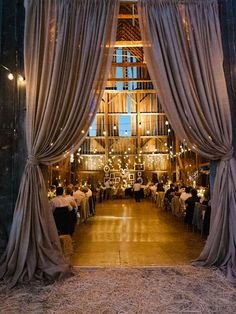 barn wedding decro with curtains, strung lights, candles, burlap #wedding #weddingideas #barnwedding