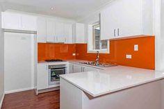 granny flat kitchen with orange splash back