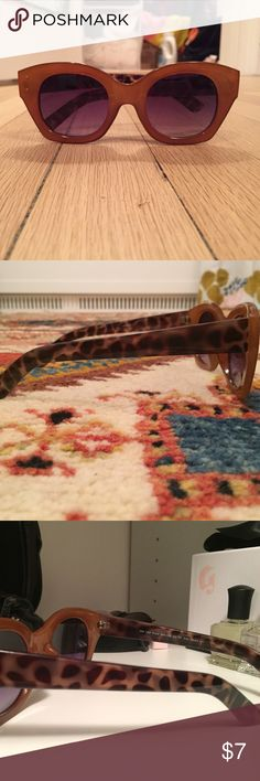 Urban Outfitters Sunglasses chunky and retro shades from UO last spring! unworn without tags, perfect condition. frames are a light orange-y brown and sides are a very 60s leopard print. Googled hard but couldn't find an original image from Urban Outfitter's site so I included one of a differ pair that fit almost exactly the same way. also took a guess on the original price and all offers welcome! Urban Outfitters Accessories Sunglasses
