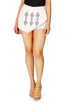 Bold and lively, Aztec Embroidered Skort by JustFab features front embroidery, an elastic waist, two back pockets and an asymmetrical overlay.