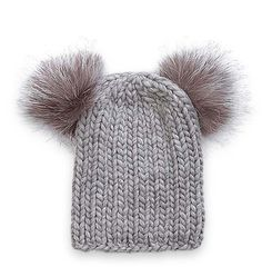 Grey pom-poms £165, Eugenia Kim http://www.matchesfashion.com/ (From: Woolly hats: the wish list – in pictures, Theguardian.com)