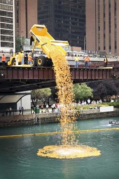 """For the fourth year in a row, Komatsu America Corp. helped launch more than 20,000 rubber ducks into the Chicago River in the annual """"Windy City Rubber Ducky Derby"""" to benefit the Special Olympics."""