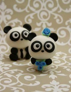 Polymer clay panda pair.