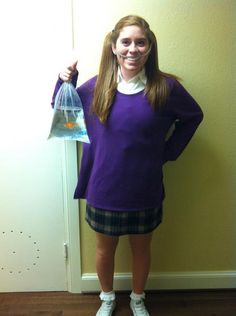 Darla from Finding Nemo! This is a great costume idea. I just hope the fish in the bag isn't real... poor guy!