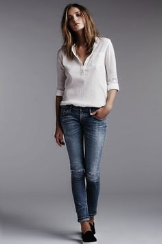 The original neutral, casual outfit. White blouse and jeans.